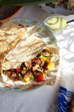 Gyro. Greek gyro with lavash, sauce and onion. Gyro is made of fried chicken, tomatoes, cucumbers, cabbage, paprika sweet pepper and natural yoghurt. Seasoning Stock Photos
