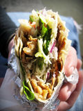 Gyro kabob. Closeup of a gyro kabob held in an unknown person's hand Stock Photography
