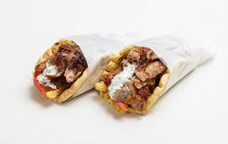 Gyro pita, shawarma, take away, street food. Traditional greek turkish, meat food isolated on white background. Gyro pita, shawarma, take away, street food. Two stock image