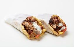 Gyro pita, shawarma, take away, street food. Traditional greek turkish, meat food isolated on white background. Gyro pita, shawarma, take away, street food. Two stock photos
