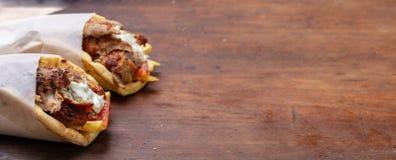 Gyro pita, shawarma, take away, street food. Traditional greek turkish, meat food on wooden table. Gyro pita, shawarma, take away, street food. Two pita bread royalty free stock photography