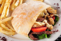 Gyro or shawarma sandwich. Stuffed pita bread with chicken, meat and vegetables Royalty Free Stock Photography