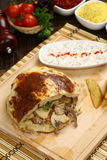 Gyro or shawarma sandwich. Stuffed pita bread with meat,chicken and vegetables royalty free stock photography