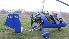 Gyrocopter. Crew of pilots ready to take off with gyrocopter stock video footage