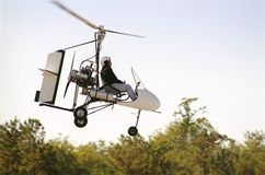 Gyrocopter in flight stock photo