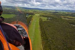 Gyrocopter is landing on an airfield out of gras, Byron Bay, Queensland, Australia. Aerial, airport, view, ocean, travel, beach, blue, sea, tourism, water stock photography