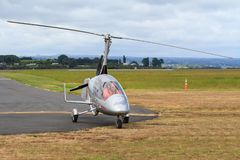 A gyrocopter, also known as an autogyro, on a landing strip stock photography