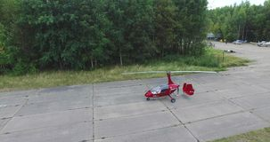 Gyroplan Prepares For Takeoff 4k. 4k Aerial shot of the gyroplan moves on the runway before take-off stock video
