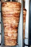 Gyros. Roasted gyros in the Greek restaurant Stock Image