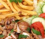 Gyros. With french fries and vegetables Stock Image