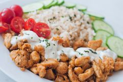 Gyros chicken with rice, tzatziki dressing and vegetables Royalty Free Stock Photography