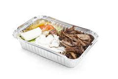 Gyros, Fast food. A take away plate with gyros meat and salad Stock Photography