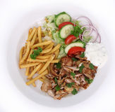 Gyros with french fries and vegetables Stock Photos