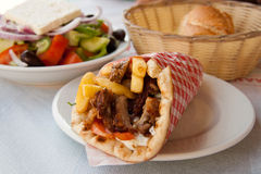 Gyros Pita, mediterranean street food and salad. Gyros, classic Greek pita sandwiches, are a favourite street food in Greece and are the Greek version of fast Stock Photo