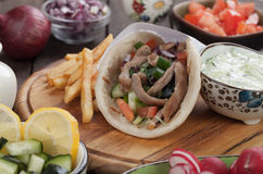 Gyros pita wrapped sandwich Stock Image