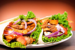 Gyros on plate. Selective focus on the left gyros Stock Images