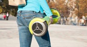 Gyroscooter, piernas, asno, cierre para arriba Imágenes de archivo libres de regalías