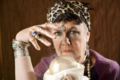 Gyspy with a crystal ball. Female gypsy fortune teller with a crystal ball Stock Photography