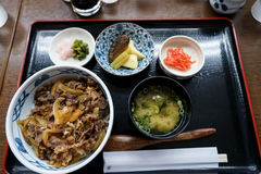 Gyudon or beef bowl, a japanese popular dish, in combo set including rice bowl, miso soup, pickle and other side dishes Royalty Free Stock Photos