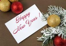Hámster en el fondo de las decoraciones del ` s del Año Nuevo Fotografía de archivo libre de regalías