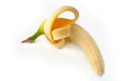 Hälfte abgezogene Banane Lizenzfreies Stockbild