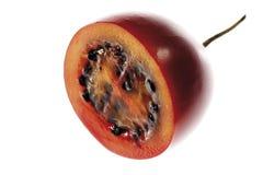 Hälfte der Tamarillofrucht, Nahaufnahme Stockbild