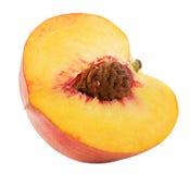Hälfte des Pfirsiches lokalisiert auf dem weißen Hintergrund Lizenzfreie Stockfotografie
