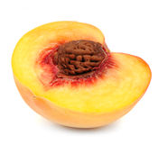 Hälfte des Pfirsiches lokalisiert auf weißem Hintergrund Lizenzfreies Stockfoto