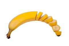 Hälfte geschnittene Banane - ungeschält Stockfotos