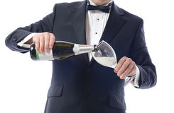 Hällande champagne för smoking fotografering för bildbyråer