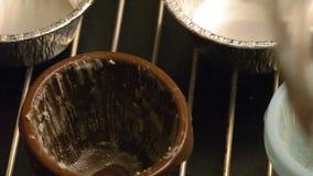 Hällande chokladsmet lager videofilmer