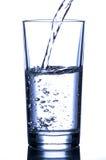 hällande vatten för exponeringsglas Royaltyfria Bilder