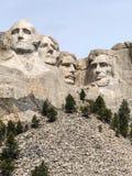Hällristning av fyra presidenter på Mt rushmore Arkivfoto