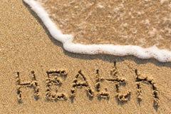 Hälsa - inskrift på sandstranden Fotografering för Bildbyråer