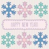 Hälsningar för snöflingor och för nytt år arkivfoton