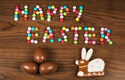 Hälsningar från lyckliga sötsaker för en påsk Arkivbild