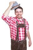Hälsningbavarianman med läderflåsanden och den traditionella hatten Royaltyfri Fotografi