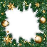 Hälsningkort för glad jul av guld- garneringar på jul Arkivfoto
