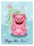 Hälsningkort för glad jul med ett svintecken royaltyfri fotografi