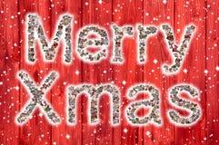 Hälsningkort för glad jul med text av en collage i röd sänka Royaltyfria Foton