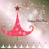 Hälsningkort för lyckligt nytt år med elefanten och snöflingor Arkivfoto