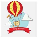 Hälsningkort med ballongen och moln för varm luft Arkivbild