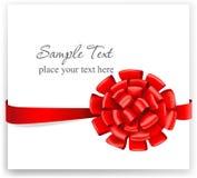 Hälsningkort med ett rött band Royaltyfri Foto