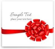 Hälsningkort med ett rött band Arkivbild