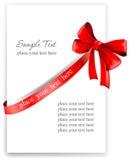 Hälsningkort med ett rött band Arkivfoton
