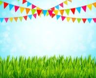 Hälsningkort med färgrika flaggor och grönt gräs Royaltyfria Bilder