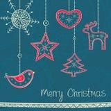 Hälsningkort med julgrangarnering på tu Arkivfoto