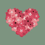 Hälsningkort om förälskelse Hjärta från röda och rosa färgblommor Arkivfoton