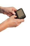 Hände auf Mobiltelefon-Tastatur Texting Stockfoto