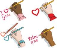 Hände Day.female des Valentinsgrußes mit den Zeichenstiften Lizenzfreie Stockfotos
